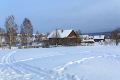Russian old-believer village Visim in winter. Ural mountains, Russia. Winter in Russian old-believer village Visim, situated in the low Middle Ural Mountains of royalty free stock photo