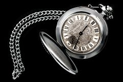 Russian old pocket watch. Old pocket watch with chain isolated on black background Stock Images