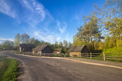 Russian old village along the road. Wooden houses in the old Russian village royalty free stock image
