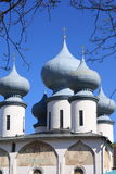 Russian Orthodox church against the blue sky. The onion-shaped domes of a russian orthodox church on a bright sunny day Royalty Free Stock Photography