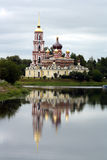 Russian orthodox church on the bank of a river. In Staraya Russa Stock Photo