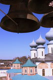 Russian Orthodox church and the bells. The onion-shaped domes of a russian orthodox church and the bells of its bell tower on a bright sunny day Royalty Free Stock Photo