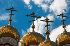 Russian Orthodox church domes. Golden domes of Russian Orthodox church with blue sky and cloudscape background Stock Photography