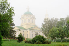 Russian Orthodox church and green trees in morning haze, Orel, R Royalty Free Stock Photos