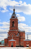 Russian Orthodox church from a red brick. Against the sky with clouds Royalty Free Stock Image