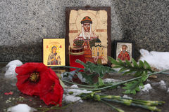 Russian orthodox icons and poppy flowers at a cemetery. Royalty Free Stock Images