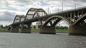 Russian orthodox Transfiguration cathedral and motor way bridge. Day shot of russian orthodox Transfiguration cathedral and motor way bridge located in Rybinsk stock footage