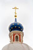 Russian orthodoxy church on white. Russian province orthodoxy church with blue cupolas Stock Photo