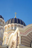 Russian ortodoxal cathedral in latvia riga. On blue sky background in evening Royalty Free Stock Images