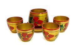 Russian painted wooden honey pot with four cups  i Royalty Free Stock Image