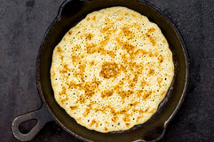 Russian pancake blin in a frying pan Royalty Free Stock Image