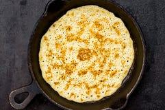 Russian pancake blin in a frying pan Royalty Free Stock Image