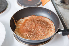 Russian pancake on pan Royalty Free Stock Photos