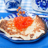 Russian pancake and red caviar Royalty Free Stock Image