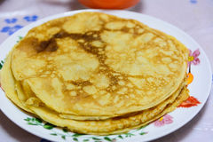 Russian pancake at Shrovetide. Photo of Russian pancakes on a plate during the carnival celebration Stock Photography