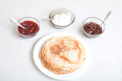 Russian pancakes. With sour cream and jam Royalty Free Stock Photo