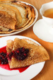 Russian pancakes with berries Stock Images