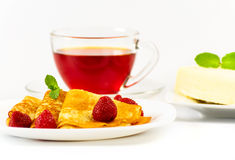 Russian pancakes with black tea and strawberries. Stock Photos