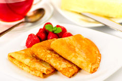Russian pancakes with black tea and strawberries. Royalty Free Stock Photography