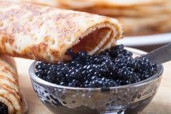 Russian pancakes - blini with black caviar royalty free stock photos