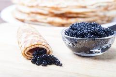 Russian pancakes - blini with black caviar stock photos