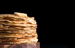 Russian pancakes blini on black with copy space royalty free stock image