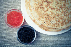 Russian pancakes - blini with red and black caviar. Toned royalty free stock image