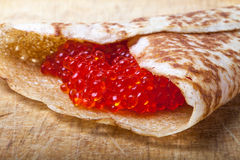 Russian pancakes - blini with red caviar Stock Photo