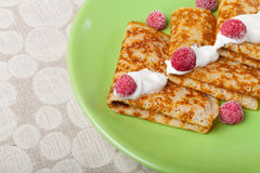 Russian pancakes - blini with sour cream topping. Selective focus.  stock photography