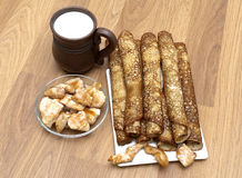 Russian pancakes, mug with milk and fried chicken. Stock Image