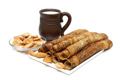 Russian pancakes, mug with milk and fried chicken pieces. Stock Photos