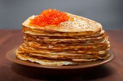 Russian pancakes  with red caviar Royalty Free Stock Images