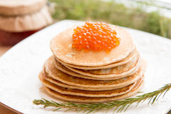 Russian pancakes with red caviar on the plate Stock Image