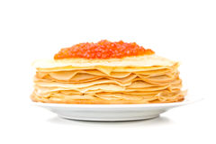 Russian pancakes with red caviar on the plate Royalty Free Stock Image