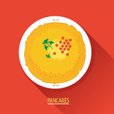 Russian pancakes with red caviar on a white plate Royalty Free Stock Image