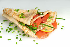 Russian pancakes. With red fish and onions Stock Image