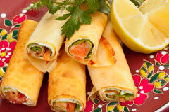 Russian pancakes with salmon Stock Images