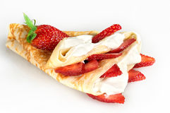 Russian pancakes. With sour cream and strawberries Stock Photos