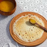 Russian pancakes with wooden spoons, honey Stock Photography