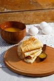 Russian pancakes with wooden spoons, honey Stock Images