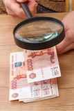 Russian paper money and magnifier Royalty Free Stock Image