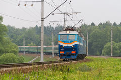 Russian passenger train in the way near Moscow. MOSCOW, RUSSIA - JULY 24, 2016: Russian passenger train in the way near Moscow in Moscow District , Russia Stock Images