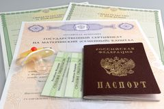 Russian passport with baby dummy and maternal, birth and pension Stock Photos