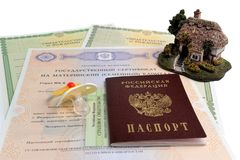 Russian passport with baby dummy, model of house and maternal, b Stock Photo