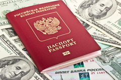 Russian passport on a background of money Royalty Free Stock Photo