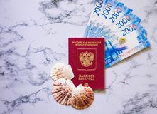 Russian passport with blue money and seashells stock image