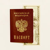 Russian passport and cash on whine Royalty Free Stock Photo