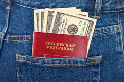 Russian passport and dollar bills in the jeans pocket Royalty Free Stock Photos