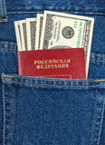 Russian passport and dollar bills in the jeans pocket Stock Photos