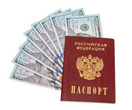 Russian passport and  dollar bills over white Royalty Free Stock Photo